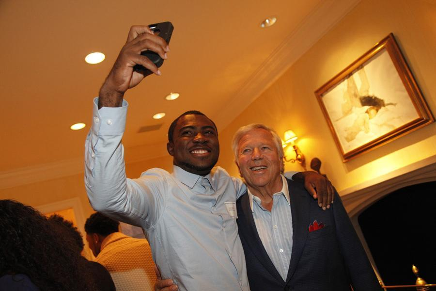 Evans Agbonsalo poses for a selfie with Robert Kraft at the Patriots owner's home.